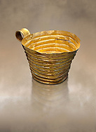 Mycenaean gold cup with horizontal grroves, Grave IV, Grave Circle A, Mycenae, Greece. National Archaeological Museum of Athens. <br /> <br /> An elegant precious gold cup hammered from thick gold to created a simple elegant design. This Mycenaean gold cup demonstrates how advance Mycenaean metalworking was in the 16th century BC. The value of the cup would have been extermely high so must have graced the table of a Mycenaean noble perhaps even a v king. .<br /> <br /> If you prefer to buy from our ALAMY PHOTO LIBRARY  Collection visit : https://www.alamy.com/portfolio/paul-williams-funkystock/mycenaean-art-artefacts.html . Type -   Athens    - into the LOWER SEARCH WITHIN GALLERY box. Refine search by adding background colour, place, museum etc<br /> <br /> Visit our MYCENAEN ART PHOTO COLLECTIONS for more photos to download  as wall art prints https://funkystock.photoshelter.com/gallery-collection/Pictures-Images-of-Ancient-Mycenaean-Art-Artefacts-Archaeology-Sites/C0000xRC5WLQcbhQ