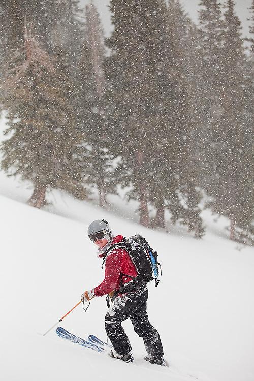 Backcountry skier Jeff Wanner standing in heavy snowfall, San Juan Mountains, Colorado.