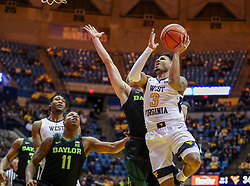 Jan 21, 2019; Morgantown, WV, USA; West Virginia Mountaineers guard James Bolden (3) drives down the lane and shoots during the second half against the Baylor Bears at WVU Coliseum. Mandatory Credit: Ben Queen-USA TODAY Sports