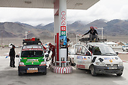 Spanish Mongol Rally teams get gas in Bayan-Ölgii Province, Mongolia, Aug. 15, 2009. One team had started in Spain and had driven through Turkey, Iran, Turkmenistan, Tajikistan, Kyrgyzstan, Kazakhstan and Russia.