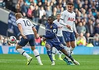 Football - 2019 / 2020 Premier League - Tottenham Hotspur vs. Watford<br /> <br /> Abdoulaye Doucoure (Watford FC)  chases down Harry Kane (Tottenham FC)  at The Tottenham Hotspur Stadium.<br /> <br /> COLORSPORT/DANIEL BEARHAM