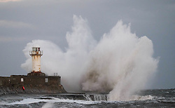 © Licensed to London News Pictures. <br /> 04/01/2017. <br /> Redcar, UK.  <br /> <br /> Large waves crash against the lighthouse and sea wall at South Gare, Redcar.<br /> <br /> Photo credit: Ian Forsyth/LNP
