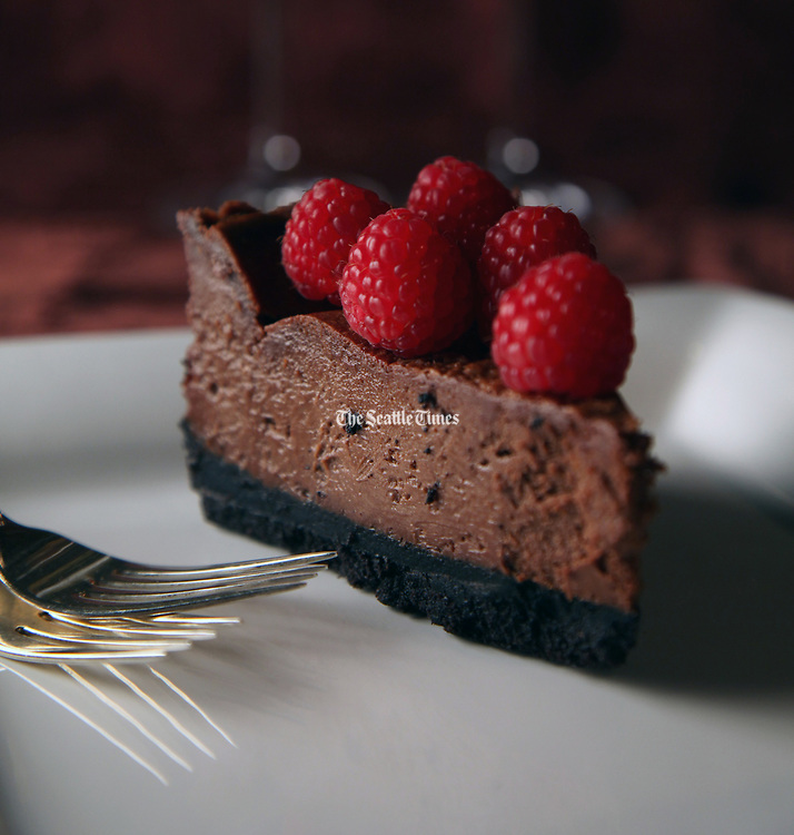 Chocolate cheesecake - A romantic Valentine's Day dessert for two. (Genevieve Alvarez / The Seattle Times)