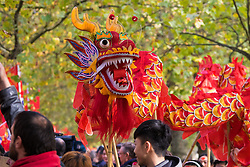 London, October 20th 2015. Following a Ceremonial welcoming to the UK by the Queen and The Duke of Edinburgh at Horse Guards Parade, a procession of carriages travels down the Mall past thousands of Chinese expatriates and Tibetan protesters. PICTURED: