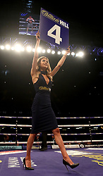 A ring girl indicates the beginning of the fourth round in the Lightweight contest at the Principality Stadium, Cardiff.
