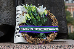 London, UK. 5 November, 2019. A wreath placed by campaigners from WASPI (Women Against State Pension Inequality) in front of the statue of Millicent Fawcett during a protest in Parliament Square to call for fair transitional pension arrangements for women born in the 1950s affected by the changes to the State Pension Age (SPA), including a 'bridging' pension to provide an income from age 60 until State Pension Age and recompense for losses incurred by women who have already reached their SPA.