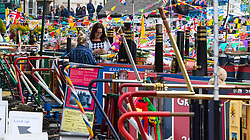 Little Venice, London, April 30th 2017. Narrowboaters from all over the UK gather for the annual Canalway Cavalcade, held on the May Day Bank holiday weekend, organised by the Inland Waterways Association, where boaters get the chance to display their immaculately prepared and brightly painted craft as well as compete in various manoeuvring tests. PICTURED:Narrowboats moored star-to in Little Venice.
