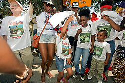 29 August 2015. Lower 9th Ward, New Orleans, Louisiana.<br /> Hurricane Katrina 10th anniversary memorials.  <br /> A second line parade passes down Tennessee Street remembering those who perished and celebrating those who survived the storm. <br /> Photo credit©; Charlie Varley/varleypix.com.