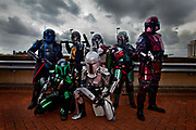 Fans of starwars costumed as Mandalorian Mercs, a Star Wars Costume Club, have travelled from Germany to attend the London Film and Comic Con LFCC is a convention held annually in London that focuses on films, cult television and comics. The convention holds a large dealers hall selling movie, comic and science fiction related memorabiliaand original film props, along with free guest talks, professional photoshoots, autograph sessions, displays. Many of the visitors / attendeesarrive dressed up as their favourite comic and sci-fi characters in the most outlandish costumes which draws from the award-winning formula of innovative gameplay..