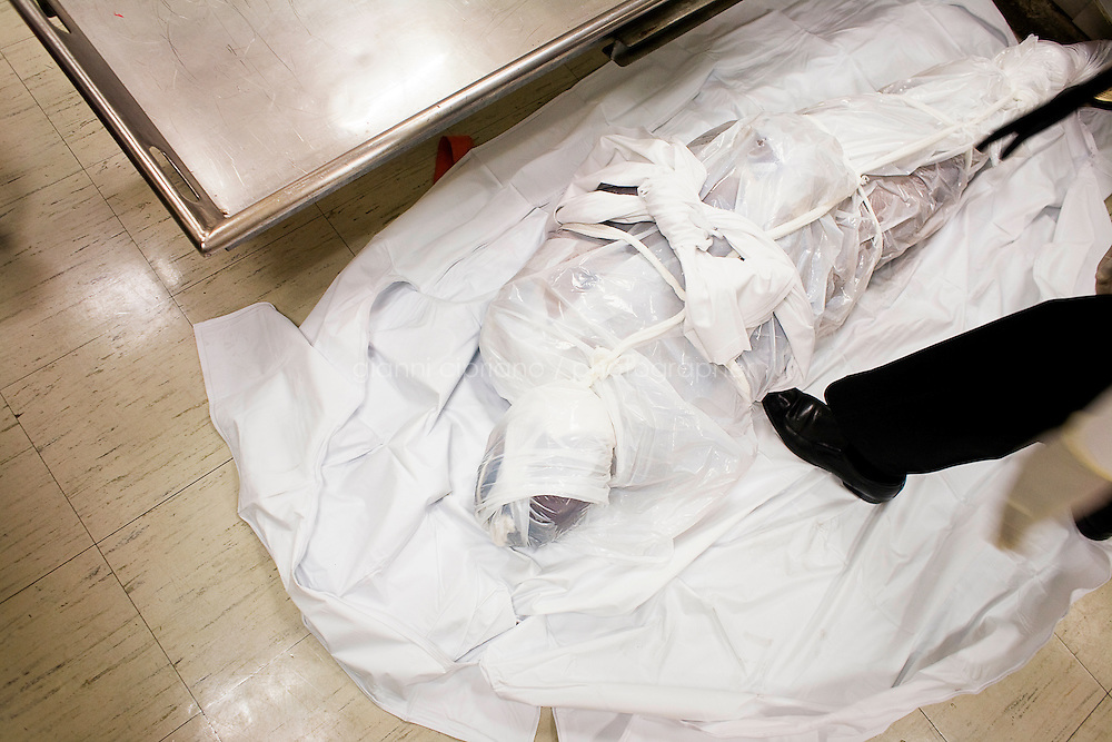 """Harlem, New York, USA - March 29.  A corpse is taken out of the morgue drawer of the Mount Sinai Hospital and is ready to being brought to the funeral home on March 29, 2008 in Harlem, New York, USA. This kind of procedure is called """"removal"""". A removal consists in picking up a body at the morgue and bring it to the funeral home."""