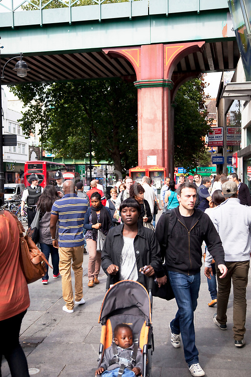 Street scene on Brixton Road, a multicultural area in South London. Brixton is a district in south London, England, in the London Borough of Lambeth. The area is identified in the London Plan as one of 35 major centres in Greater London. Brixton is predominantly residential with a prominent street market and substantial retail sector. It is a multiethnic community, with around 24 percent of Brixton's population being of African and Caribbean descent, giving rise to Brixton as the unofficial capital of the British African-Caribbean community.