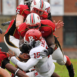Sep 26, 2009; College Park, MD, USA; Maryland defensive lineman Travis Ivey (90) tackles Rutgers quarterback Jabu Lovelace (15) during the first half of Rutgers' 34-13 victory over Maryland in NCAA college football at Byrd Stadium.