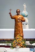 A golden statue of martyred Archbishop Oscar Romero across from the Plaza El Salvador Del mundo (Savior of the World) where preparations are being made for Saturday's ceremony and mass announcing the beatification of Archbishop Oscar Romero. The Archbishop was slain at the alter of his Church of the Divine Providence by a right wing gunman in 1980. Oscar Arnulfo Romero y Galdamez became the fourth Archbishop of San Salvador, succeeding Luis Chavez, and spoke out against poverty, social injustice, assassinations and torture. Romero was assassinated while offering Mass on March 24, 1980.