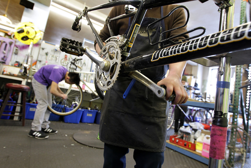 Apprentices and employees work together at Express Bike Shop in St. Paul, Minnesota.  Apprentices in the Youth Express program learn mechanical skills related to fixing bicycles, as well as customer relation and entrepreneurial skills.