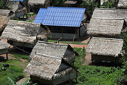 Changing incomes and lifestyles plus access to better materials and knowledge. Houses are changing from traditional grass rooved to block built buildings and tiled rooves.  Sayaboury Province, Lao PDR
