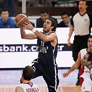 Anadolu Efes's Sasha VUJACIC (C) during their BEKO Basketball League derby match Galatasaray between Anadolu Efes at the Abdi Ipekci Arena in Istanbul at Turkey on Sunday, November 13 2011. Photo by TURKPIX