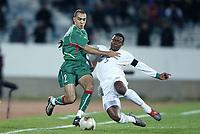Fotball<br /> African Nations Cup 2004<br /> Afrika Mesterskapet<br /> Foto: Digitalsport<br /> Norway Only<br /> <br /> FIRST ROUND - GROUP D - 040204<br /> MOROCCO v SOUTH AFRICA<br /> MAROKKO v SØR AFRIKA<br /> <br /> WALID REGRAGUI (MOR) / MBULELO  MABIZELA (RSA)