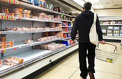 © Licensed to London News Pictures. 04/10/2021. London, UK. A shopper walks past at nearly empty shelves of frozen turkeys and meat products in Iceland, north London, amid fears of food shortages over Christmas. The Government and retailers warn that food and fuel shortages could continue until Christmas due to labour shortages following Brexit. According to Iceland, sales of frozen turkeys are up by more than 400 per cent compared to this time last year. Photo credit: Dinendra Haria/LNP