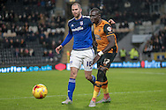 Mohamed Diamé (Hull City) and Matthew Connolly (Cardiff City) during the Sky Bet Championship match between Hull City and Cardiff City at the KC Stadium, Kingston upon Hull, England on 13 January 2016. Photo by Mark P Doherty.