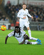 Bafetimbi Gomis of Swansea city keeps his eye on the ball.  Barclays Premier league match, Swansea city v West Ham Utd at the Liberty Stadium in Swansea, South Wales  on Sunday 20th December 2015.<br /> pic by  Andrew Orchard, Andrew Orchard sports photography.