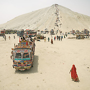 """Pilgrims arriving at Chandragup (meaning """"Moon Well""""), a sacred site to Hindu of 3 mud volcanoes (including mainland Asia's largest one)."""