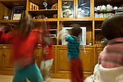 Children playing and dancing at Lambano Sanctuary, a hospice and care home for children who suffer from HIV. Guateng, South Africa.