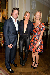 Left to right, MATTHEW BARZUN, ELLIE GOULDING and BROOKE BARZUN at a party hosed by the US Ambassador to the UK Matthew Barzun, his wife Brooke Barzun and editor of UK Vogue Alexandra Shulman in association with J Crew to celebrate London Fashion Week held at Winfield House, Regent's Park, London on 16th September 2014.