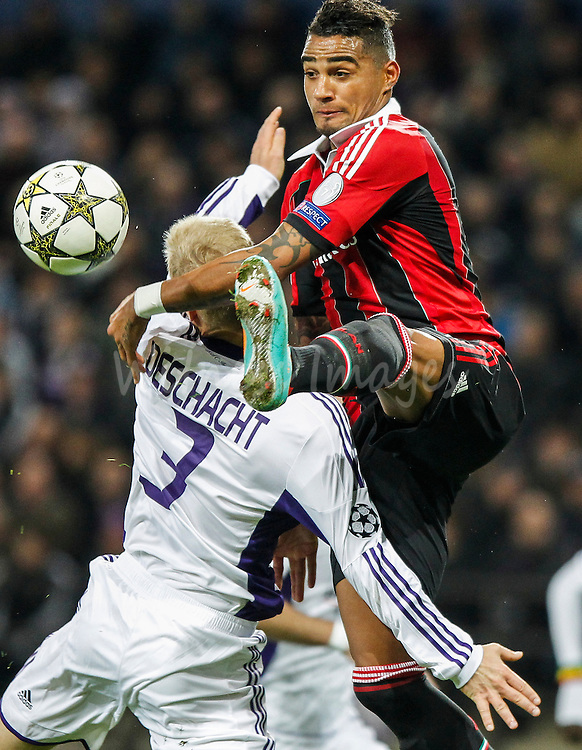 RSC Anderlecht's Olivier Deschacht (L) and Milan's Kevin Prince Boateng (R) fight for the ball during the UEFA Champions League group C soccer match between RSC Anderlecht and AC Milan, at the Constant Vanden Stock stadium, in Brussels, Belgium, 21 November 2012.