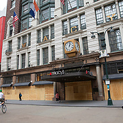Macys department store boards up windows in preparation for another expected night of protests due to the killing of George Floyd by a Minnesota Police Officer on Tuesday, June 2, 2020 in Manhattan, New York.  A citywide 8 p.m. curfew was ordered by NY Mayor Bill de Blasio amid the Floyd protests. (Alex Menendez via AP)