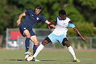 24 May 2014: USA Under-20's Andrija Novakovich (left) and Wilmington's Jason Watson (right). The Under-20 United States Men's National Team played a scrimmage against the Wilmington Hammerheads at Dail Soccer Field in Raleigh, North Carolina. Wilmington won the game 4-2.