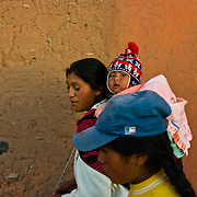 Mother and child on the island of Amantani in Lake Titicaca, Peru.
