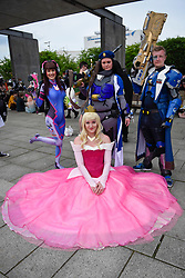 © Licensed to London News Pictures. 28/05/2017. London, UK.  Sleeping Beauty (seated) and characters from Overwatch at MCM Comic Con taking place at Excel in East London.  The three day event celebrates popular comic books, anime, games, television and movies.  Many attendees take the opportunity to dress as their favourite characters.    Photo credit : Stephen Chung/LNP