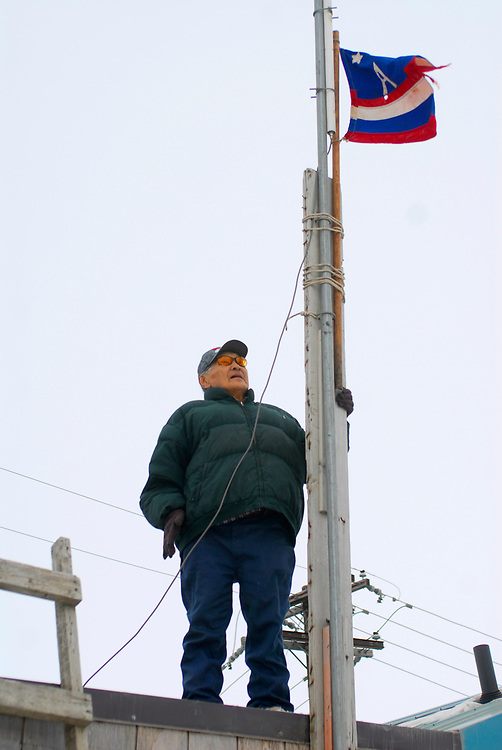 Alaska, Barrow. April 2007. Spring whaling. Old man Ahkivgak and Ahkivgak's crew flag on the top of the captain's house.