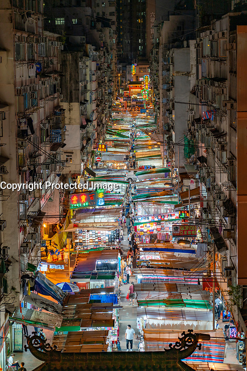 Night view of famous Temple Street Night market in Kowloon, Hong Kong.