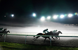 Joli's Legacy ridden by jockey Jack Mitchell (hidden right) wins the Unibet Casino Handicap with Tell'em Nowt ridden by jockey Richard Kingscote third and Strategic Fortune ridden by Adam Kirby second at Kempton Park Racecourse, Surrey. Picture date: Wednesday October 13, 2021.