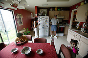 (MODEL RELEASED IMAGE). The Fernandez family enjoys an afternoon moment in the kitchen of their home in San Antonio, Texas. (Supporting image from the project Hungry Planet: What the World Eats.)