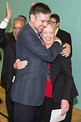 © Licensed to London News Pictures . 10/10/2014 . Heywood , UK . Labour candidate Liz McInnes hugs a member of her team as the result is declared . The count at the Heywood and Middleton by-election , following the death of sitting MP Jim Dobbin . Photo credit : Joel Goodman/LNP