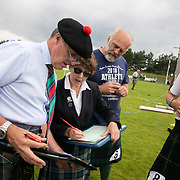 Highland Games, 3rd of August 2019, Newtonmore, Scotland, United Kingdom. Jusges revise the results after the caber tossing competition. The Highland Games is a traditional annual event where competitors compete as strong men, runners, dancers, pipers and at tug-of-war. The games go back centuries and are happening through-out the summer across Scotland. The games are both an important event locally and a global tourist attraction.