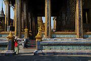 Tourist taking photo, Wat Phra Kaew - Temple of the Emerald Buddha - in the Dusit area of Bangkok.