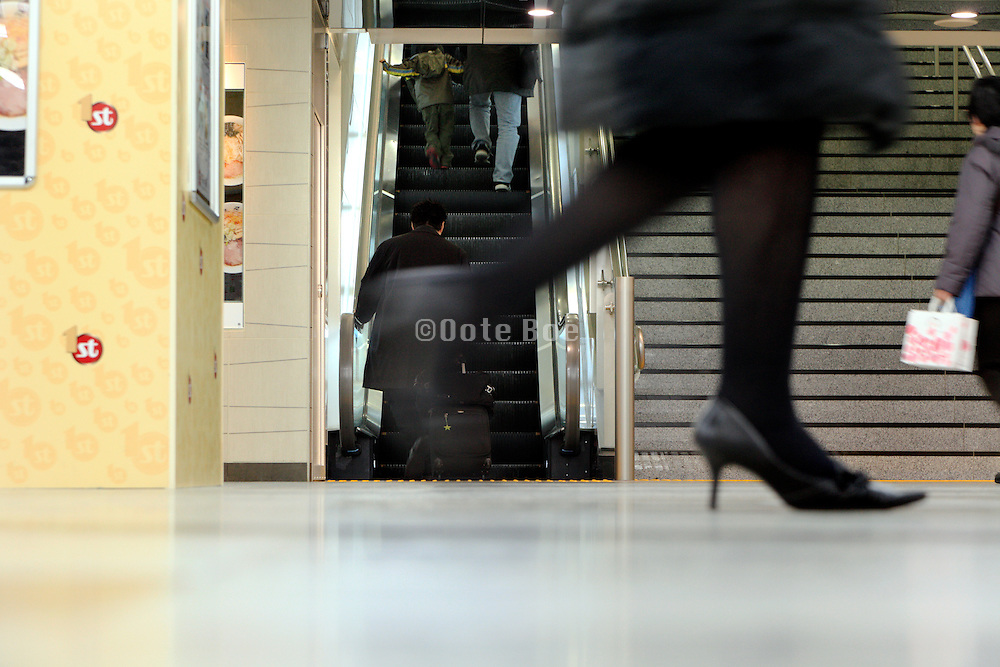 female businesswoman walking in corridor