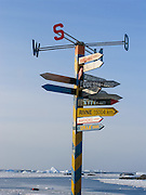 """Directional sign at Vernadsky Research Base (Akademik Vernadsky), a Ukrainian Antarctic Station at Marina Point on Galindez Island in the Argentine Islands, Antarctica. The United Kingdom first established research here as Base F or """"Argentine Islands"""" on Winter Island in 1947, then built a larger hut on Galindez Island in 1954, renamed it Faraday Station in 1977, and shocked the scientific community by discovering the Antarctic """"ozone hole"""" in 1985. The base was transferred to Ukraine in 1996."""