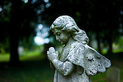 Statue of an angel in the graveyard of St Mary the Virgin Church  in Harefield, Middlesex, UK