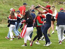 Team USA's Tony Finau celebrates winning the Ryder Cup for his team by pouring champagne over his wife Alayna Finau at the end of day three of the 43rd Ryder Cup at Whistling Straits, Wisconsin. Picture date: Sunday September 26, 2021.
