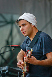 27 April 2014. New Orleans, Louisiana.<br /> Rostam Batmanglij of Vampire Weekend at the New Orleans Jazz and Heritage Festival. <br /> Photo; Charlie Varley/varleypix.com