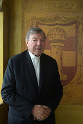 File photo - Australian Cardinal George Pell poses at his office in the San Giovanni Tower at the Vatican on Oct.16, 2014.Cardinal George Pell has been found guilty of sexual offences in Australia, making him the highest-ranking Catholic figure to receive such a conviction. Pell abused two choir boys in the rooms of a Melbourne cathedral in 1996, a jury found. He had pleaded not guilty. The verdict was handed down in December, but it could not be reported until now due to legal reasons. Pell is due to face sentencing hearings from Wednesday. He has lodged an appeal against his conviction.s. Photo by Eric Vandeville /ABACAPRESS.COM