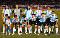 """BUENOS AIRES, ARGENTINA - MARCH 28, 2009.<br /> 2010 FIFA World Cup qualifying Soccer match between ARGENTINA and VENEZUELA in the River Plate Stadium.<br /> Here Argentine NAtional Team.<br /> At the back a pancart """"MARADONA and other more eleven"""".<br /> © PikoPress"""