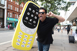 Comedian Dom Joly recreates a Trigger Happy TV moment to launch the new Nokia 3310 at Carphone Warehouse on Oxford Street, London.