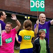 NLD/Amsterdam/20100807 - Boten tijdens de Canal Parade 2010 door de Amsterdamse grachten. De jaarlijkse boottocht sluit traditiegetrouw de Gay Pride af. Thema van de botenparade was dit jaar Celebrate, politicus Boris van der Ham
