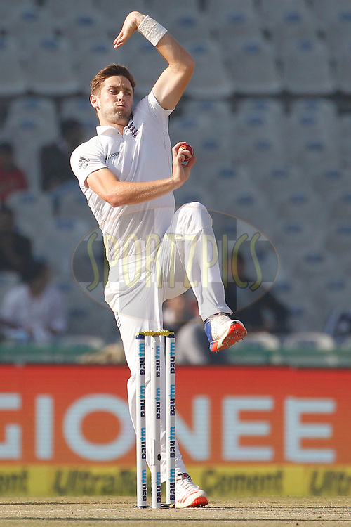 Chris Woakes of England bowls a delivery during day 2 of the third test match between India and England held at the Punjab Cricket Association IS Bindra Stadium, Mohali on the 27th November 2016.<br /> <br /> Photo by: Deepak Malik/ BCCI/ SPORTZPICS