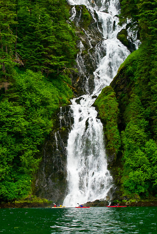 Sea kayaking in front of Red Bluff Bay Falls, Red Bluff Bay, Inside Passage, Southeast Alaska